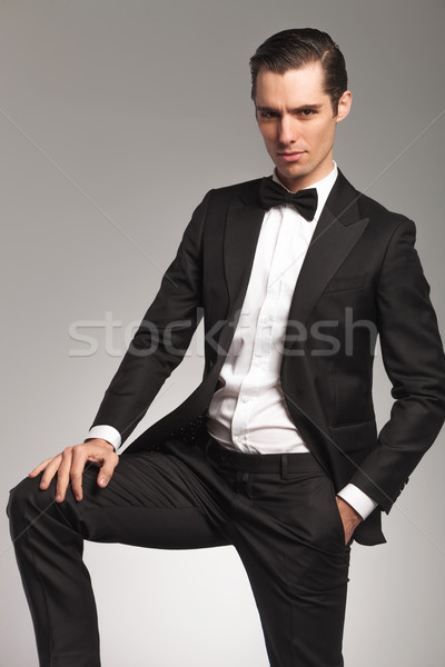 elegant man with hand on knee and one in pocket Stock photo © feedough