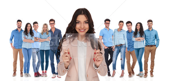businesswoman leader showing futuristic gadget in front of her g Stock photo © feedough