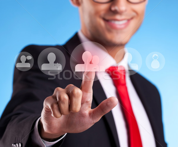 Stock photo: Business man pressing round social buttons