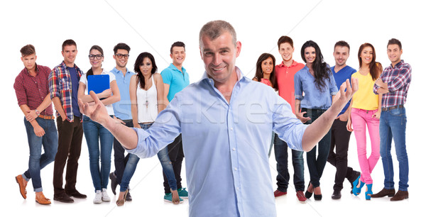 mature casual man welcoming to his young team Stock photo © feedough