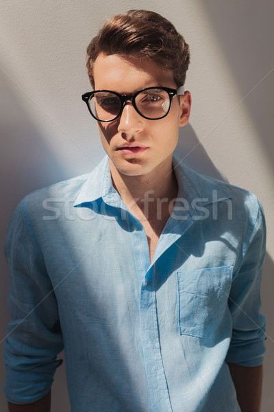 handsome young casual man wearing a blue shirt Stock photo © feedough