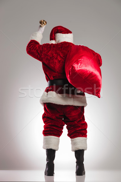 back view of santa claus ringing bell  Stock photo © feedough