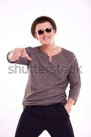 указывая стороны кармана фотография случайный Сток-фото © feedough