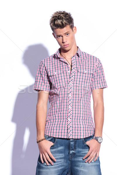 casual man with fingers in pockets Stock photo © feedough