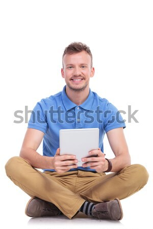 seated happy casual man working on his tablet  Stock photo © feedough