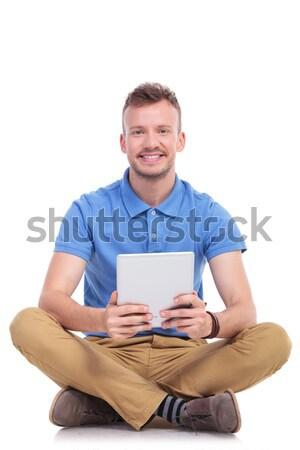 сидящий счастливым случайный человека рабочих таблетка Сток-фото © feedough