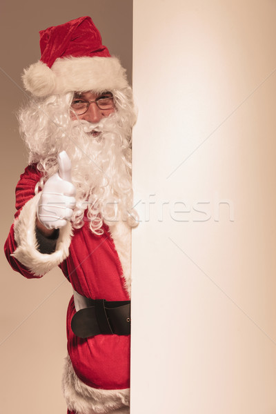 Santa Claus holding a blank panel  Stock photo © feedough