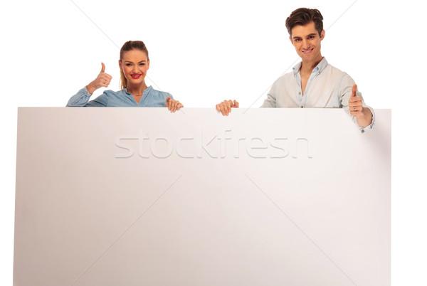 Stockfoto: Paar · poseren · billboard · knap · geïsoleerd