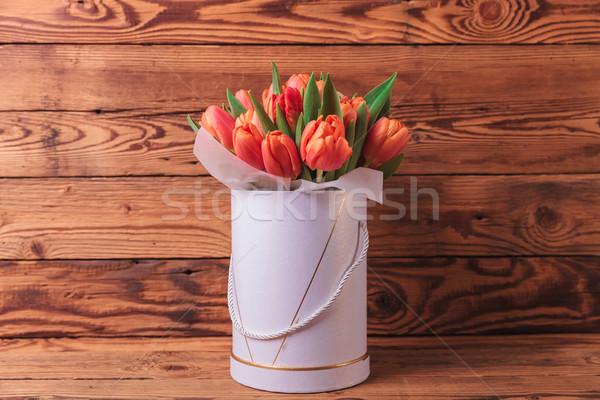 spring tulips flowrs arrangement on old wood background Stock photo © feedough