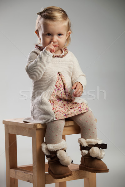 adorable little girl picking her nose while sitting Stock photo © feedough