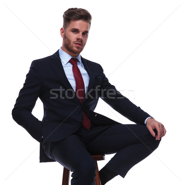 young handsome businessman in navy suit resting on wooden chair Stock photo © feedough