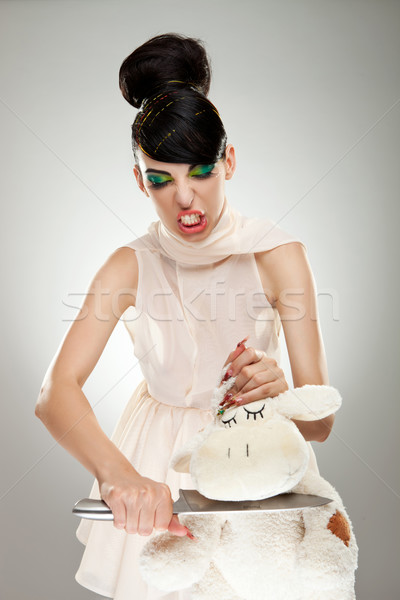woman cutting the neck of her teddy bear  Stock photo © feedough