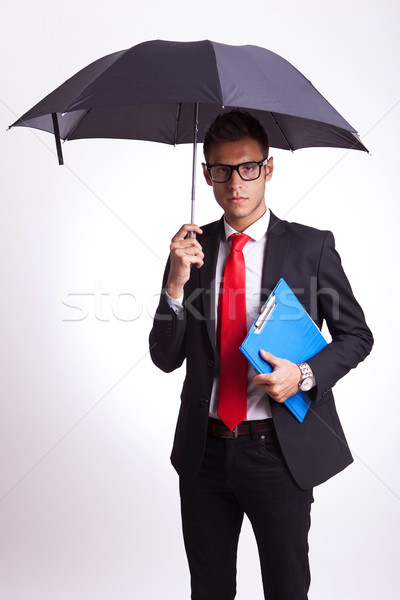business man with umbrella and notepad Stock photo © feedough