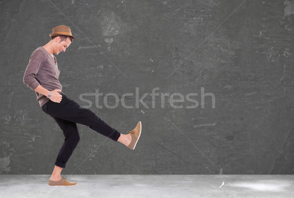 young man kicking and smiling Stock photo © feedough