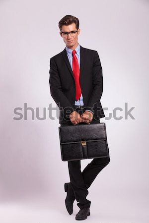holding suitcase with both hands Stock photo © feedough