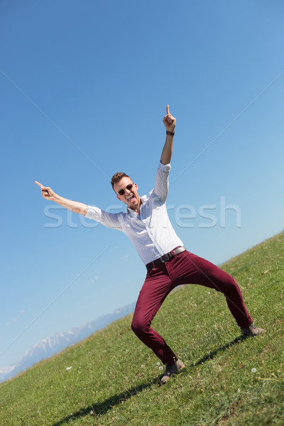 outdoor casual man cheers and shouts Stock photo © feedough