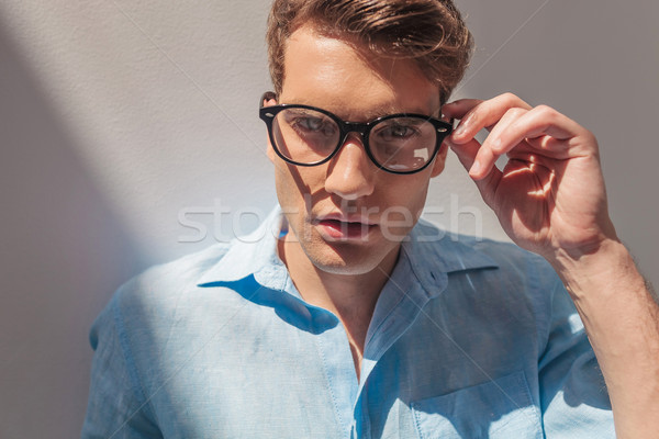 handsome casual man taking off his glasses. Stock photo © feedough