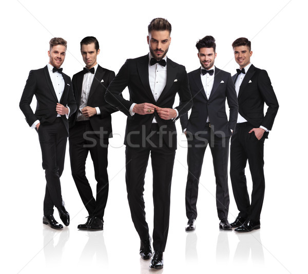 group of five elegant men with leader buttoning suit Stock photo © feedough