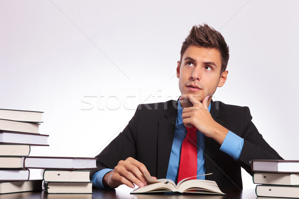 contemplative man reads at desk Stock photo © feedough