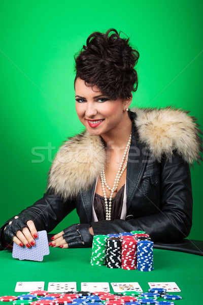 sexy girl smiles at poker table Stock photo © feedough