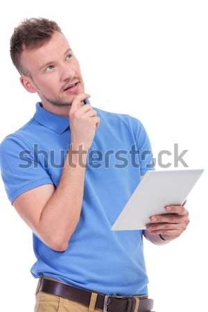 Mosolyog férfi olvas érdekes tabletta töprengő Stock fotó © feedough
