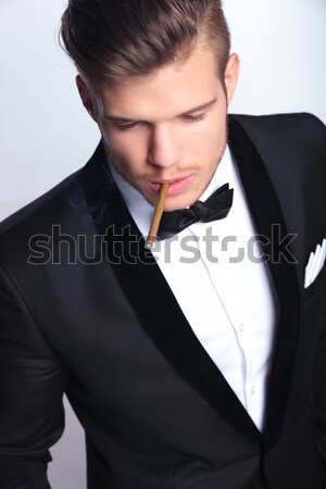 young business man touches his lip Stock photo © feedough