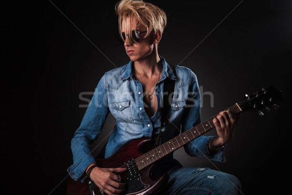 passionate guitarist playing his electric guitar  Stock photo © feedough