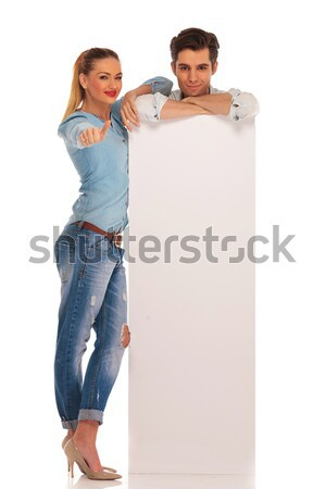 full body picture of couple smiling and holding speech bubbles  Stock photo © feedough