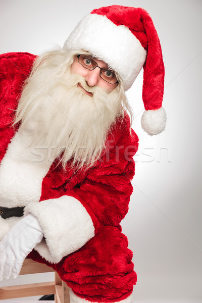 cutout image of santa claus resting on a chair  Stock photo © feedough