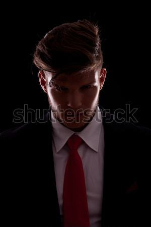 sexy and dark fashion man pulling his suit collar Stock photo © feedough