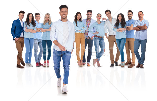 happy casual group leader stepping in front Stock photo © feedough