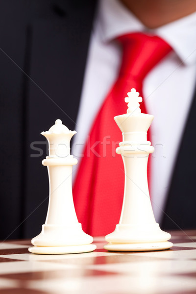 White chess king and queen in front of business suit Stock photo © feedough