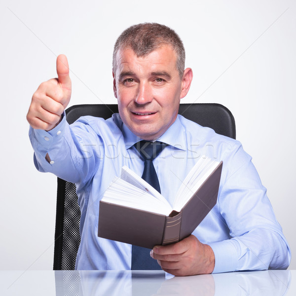 old business man with book shows thumb up Stock photo © feedough
