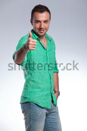 случайный человека указывая оба рук молодые Сток-фото © feedough