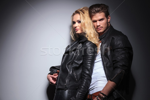 Attrative young fashion man holding his girlfriend Stock photo © feedough