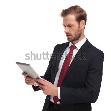 ülő fiatal üzletember tart tabletta számítógép Stock fotó © feedough