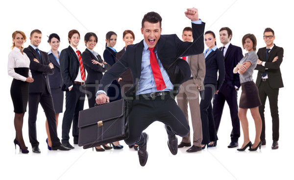 young leader jumping for joy in front of his team Stock photo © feedough