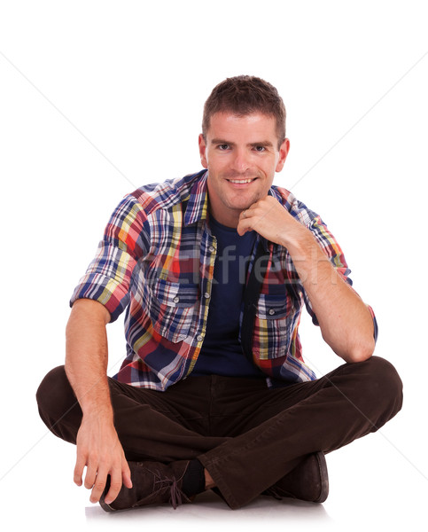 young man sitting and smiling Stock photo © feedough