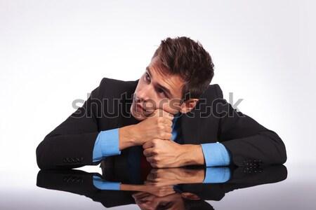 Marzyciel człowiek posiedzenia biurko młodych zamyślony Zdjęcia stock © feedough