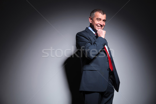 middle aged business man holding his hand to the chin Stock photo © feedough