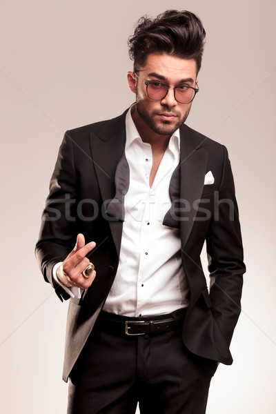 young elegant business man snapping his fingers Stock photo © feedough