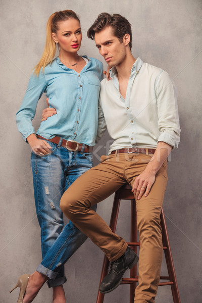 man seated embracing girlfriend while looking away in studio Stock photo © feedough