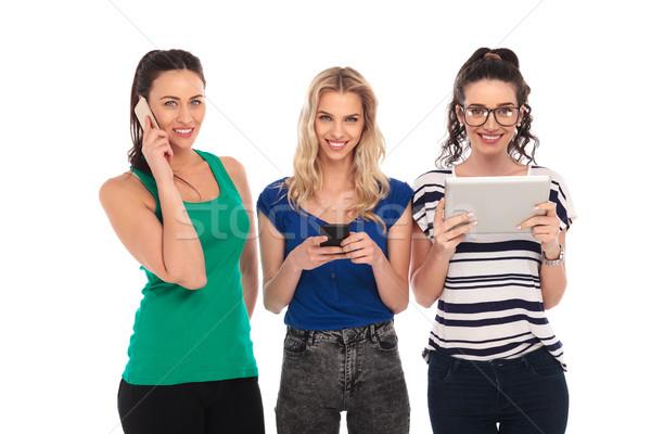 happy women communicating in different ways Stock photo © feedough