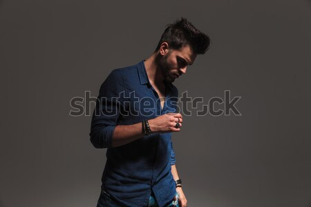 side view of a fashion man looking down  Stock photo © feedough