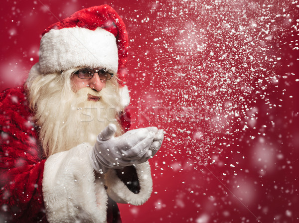 santa claus is blowing snow flakes out of his palms  Stock photo © feedough
