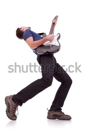 Széles látószögű fiatal gitáros játszik fehér divat Stock fotó © feedough