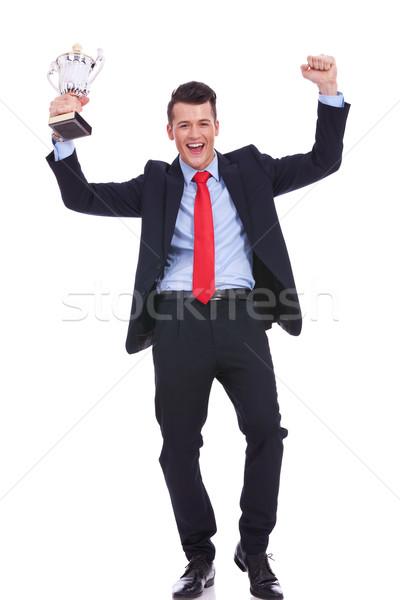 Geschäftsmann halten Gold Trophäe Bild Stock foto © feedough