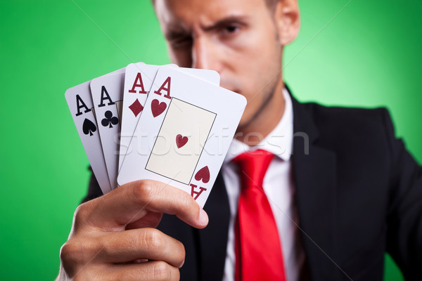 young business man showing a four of a kind hand of aces Stock photo © feedough
