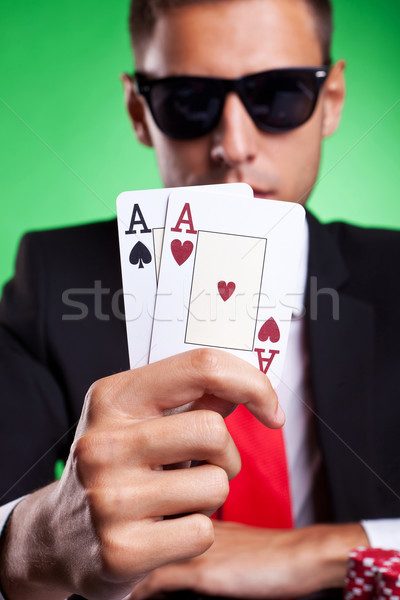Young business man showing you his pair of aces Stock photo © feedough