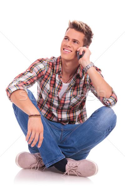 sitting and speaking on phone Stock photo © feedough